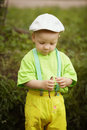 Little boy with fish in hands outside Stock Photos