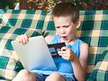 Little boy with floppy disk and tablet pc Royalty Free Stock Photo