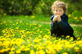 Little boy flowers field image has attached release Stock Image