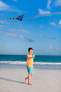 Little boy flying a kite Stock Photo