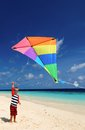 Little boy flying a kite on beach Royalty Free Stock Photo