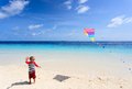 Little boy flying a kite on tropical beach Royalty Free Stock Photo