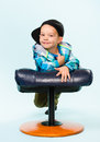Little boy and footstool on posing with a studio shot light blue background Stock Photo