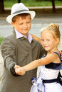 A little boy and a girl dancing a slow dance Stock Photos