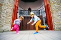 Little boy and girl dancing on stage in  Park. Royalty Free Stock Photo