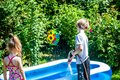 Little boy and girl filling swimming pool with water Royalty Free Stock Photo