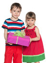 Little boy and girl hold a gift box two smiling children on the white background Stock Images