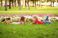 Little boy and girl lying on the grass love concept couple of kids holding hands looking eye to eye Stock Photography
