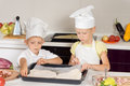 Little boy and girl making homemade pizza Royalty Free Stock Photo