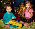 Little boy and girl near Christmas tree Stock Image
