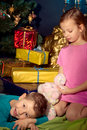 Little boy and girl near Christmas tree Royalty Free Stock Photography