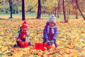 Little boy and girl play with autumn leaves in nature Royalty Free Stock Photo