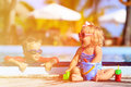 Little boy and girl playing in swimming pool at beach Royalty Free Stock Photo