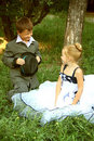 A little boy and girl in a romantic scene Royalty Free Stock Image