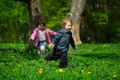 Little boy and girl running away Royalty Free Stock Image