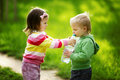 Little boy and girl sharing bottle of water