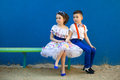 Little boy and girl sitting at bench fall in love. Royalty Free Stock Photo