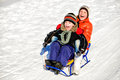 Little boy and girl on sleigh winter Stock Photography