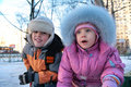 Little boy and girl on street in winter 2 Stock Images