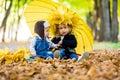 Little boy with a girl under an umbrella from the rain autumn