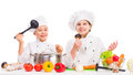 Little boy and girl with vegetables for soup on table Royalty Free Stock Photo