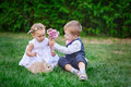 Little boy gives a girl a bouquet of flowers Royalty Free Stock Photo