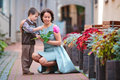 Little boy giving flower to his mom Stock Image