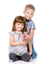 Little boy giving flowers to girl isolated on white background Royalty Free Stock Images