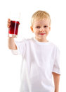 Little boy with a glass of juice Royalty Free Stock Photography