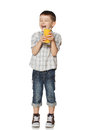 Little boy with a glass of juice laughs this image has attached release Royalty Free Stock Photos