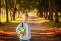 Little boy going back to school. Child with backpack and books. Royalty Free Stock Photo