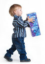 Little boy going with big box in his hands isolated on white Stock Image