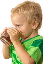 Little boy in a green T-shirt happily drinking tea Royalty Free Stock Photo