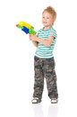 Little boy happy with plastic water gun isolated on white background Royalty Free Stock Images