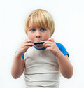 Little boy harmonica Stock Photo