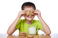 Little boy has breakfast cookies and milk isolated Royalty Free Stock Photo