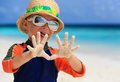 Little boy having fun on beach vacation Royalty Free Stock Photo