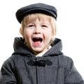 Little boy having fun laughing happy isolated on white background in autumn coat and hat Stock Photo