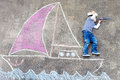 Little boy having fun with ship picture drawing Royalty Free Stock Photo
