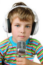 Little boy and headphone with microphone Stock Photos