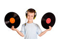 Little boy with headphones and records Royalty Free Stock Image
