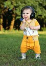 Little boy with headphones smiling Royalty Free Stock Photography