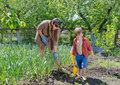 Little boy helping his mother in the garden Royalty Free Stock Photo
