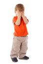 Little boy hide face under hands Royalty Free Stock Photos