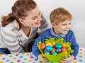 Little boy and his mother being happy about selfmade Easter eggs Royalty Free Stock Photo