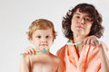 Little boy with his mother brush your teeth Royalty Free Stock Photography