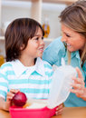 Little boy and his mother preparing his snack Royalty Free Stock Photos