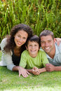 Little boy with his parents lying down Royalty Free Stock Image