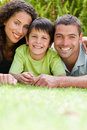 Little boy with his parents lying down Royalty Free Stock Photo