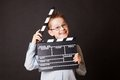 Little boy holding clapper board in hands cinema concept Stock Image